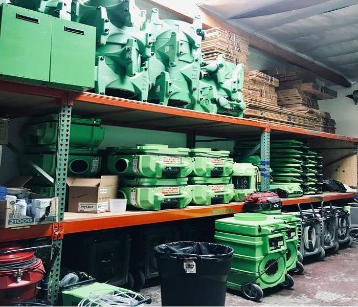 Variety of airmovers, dehus and desicants stacked in the warehouse of 3 levels.