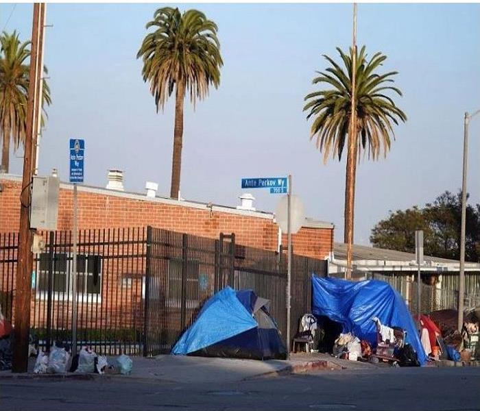 Street Corner with blue tents set up for the homeless