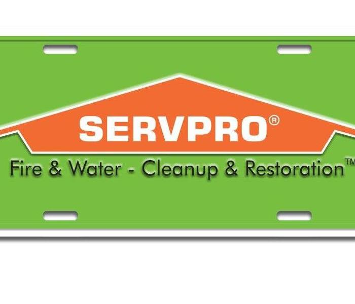 A plaque with the Servpro Logo of SERVPRO Fire & Water- Cleanup & Restoration.
