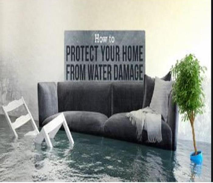 Grey Loveseat with white wooden chair that is engulfed in about a foot of standing water.